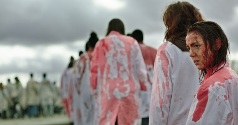 a lot of girls in a field covered in blood