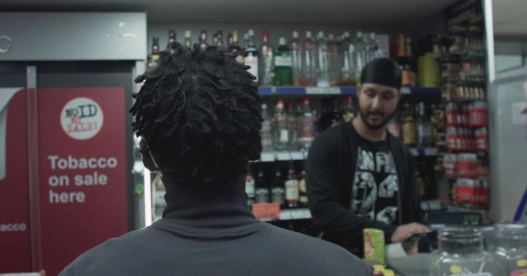the back of a boys head in an off licence