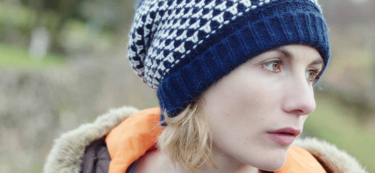 close up of a women wearing a beanie hat