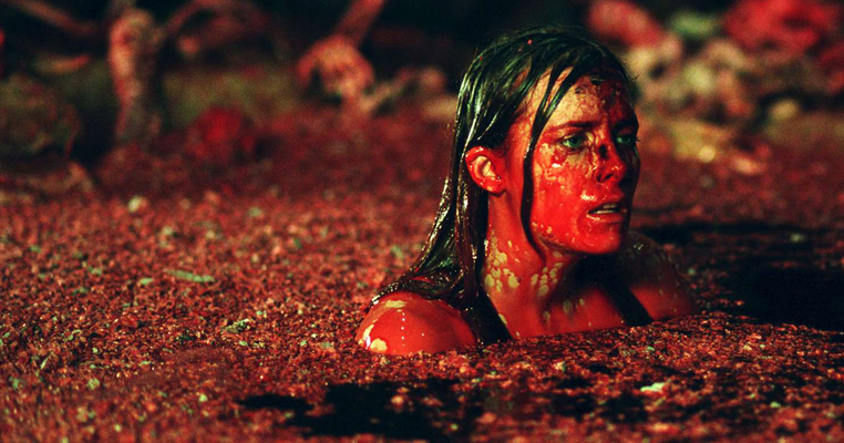 a girl covered in blood in a pool of blood
