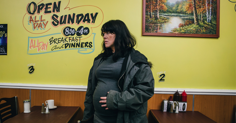 a pregnant woman in a cafe