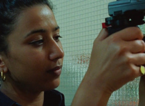 a girl holds a camera in hands