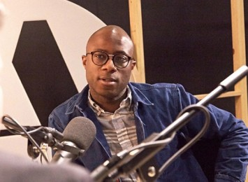 Barry Jenkins in a studio recording for a podcast