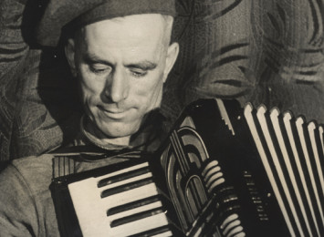 a man playing an accordion