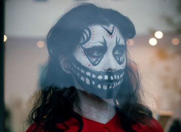 a woman with face paint like a skeleton