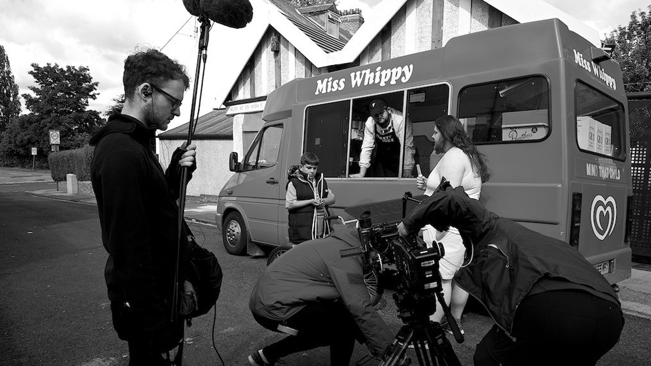 a film crew outside an ice-cream van