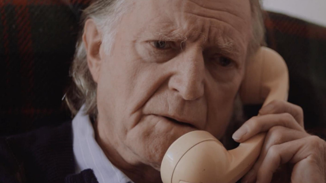 a old man on a telephone