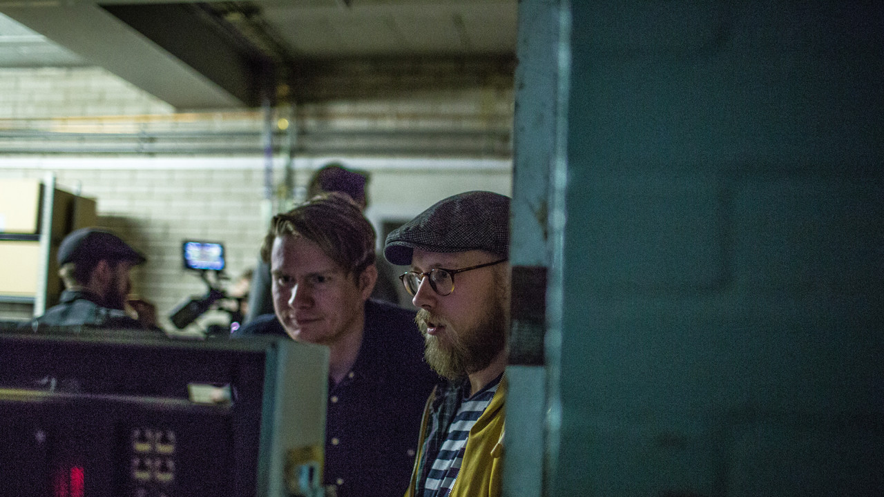 two team members on a film set
