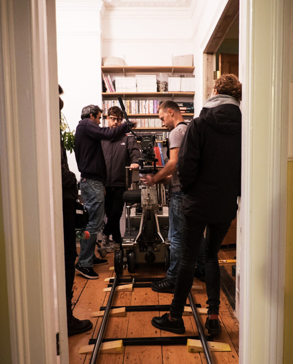 some men in a house with film equipment