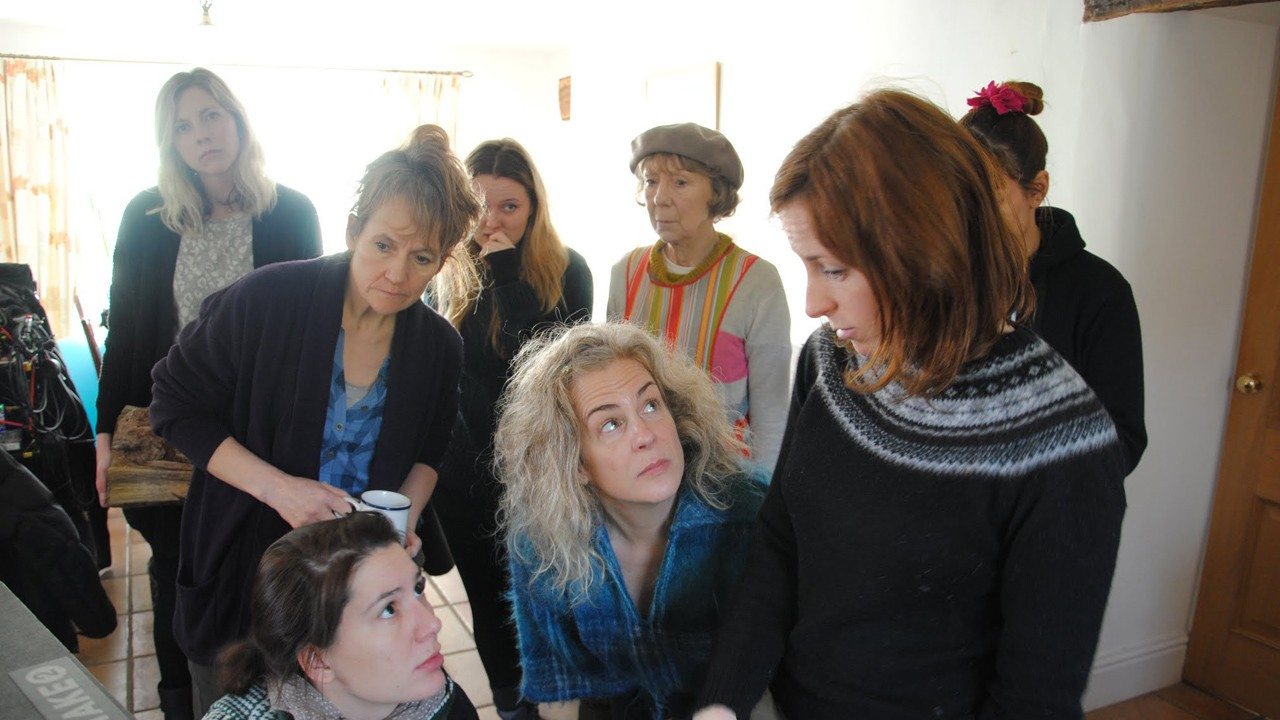 women looking into a monitor on a film set