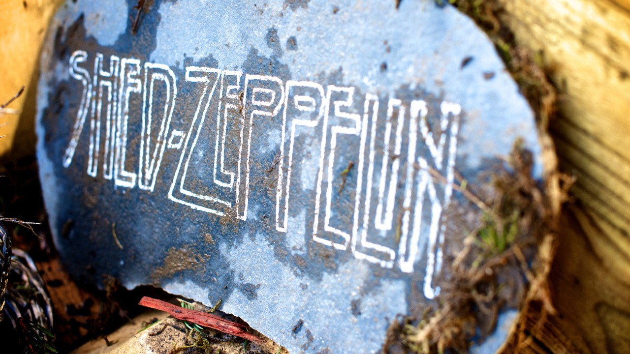 "a sign outside a shed saying ""Shed Zeppelin"""