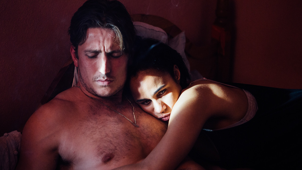 a man and a woman hugging in bed