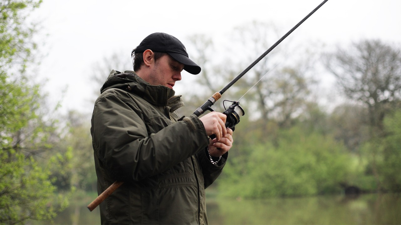 a man is setting up his rod