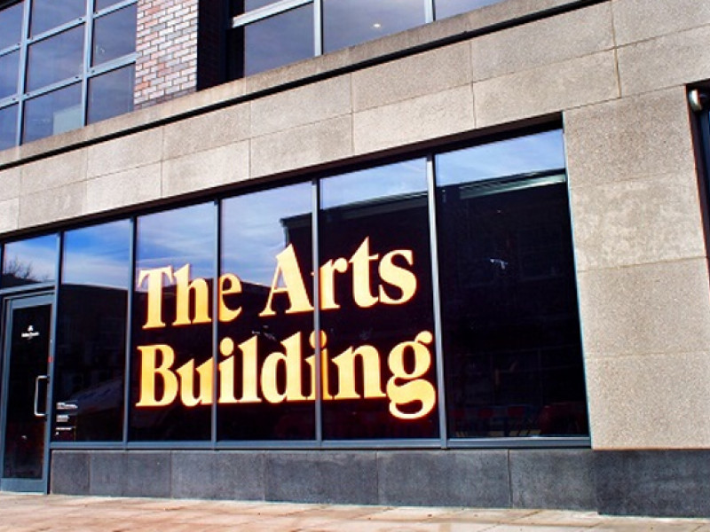 a building with letters on it saying 'The Arts Building'