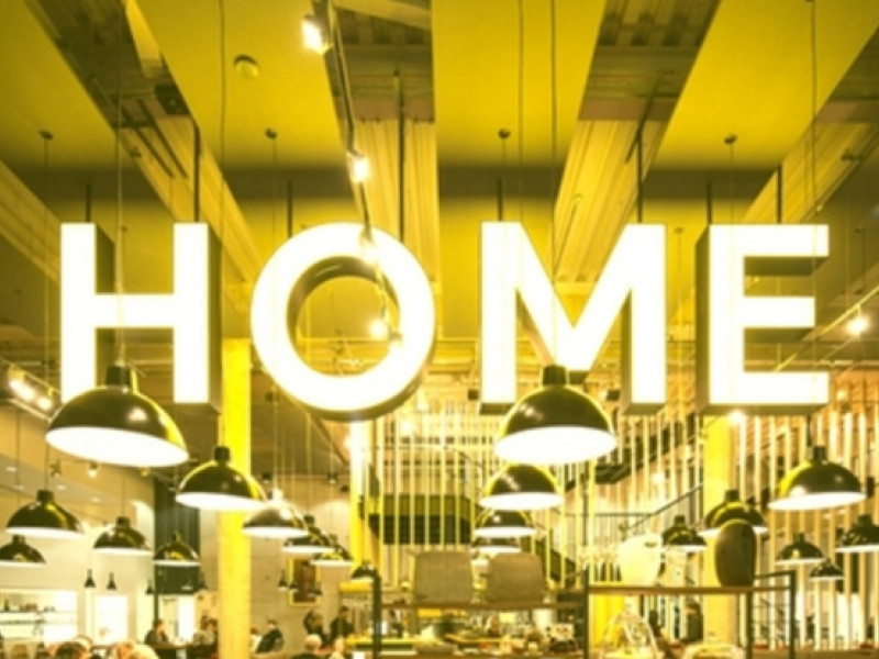Neon sign saying HOME