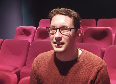 a man sitting in a cinema