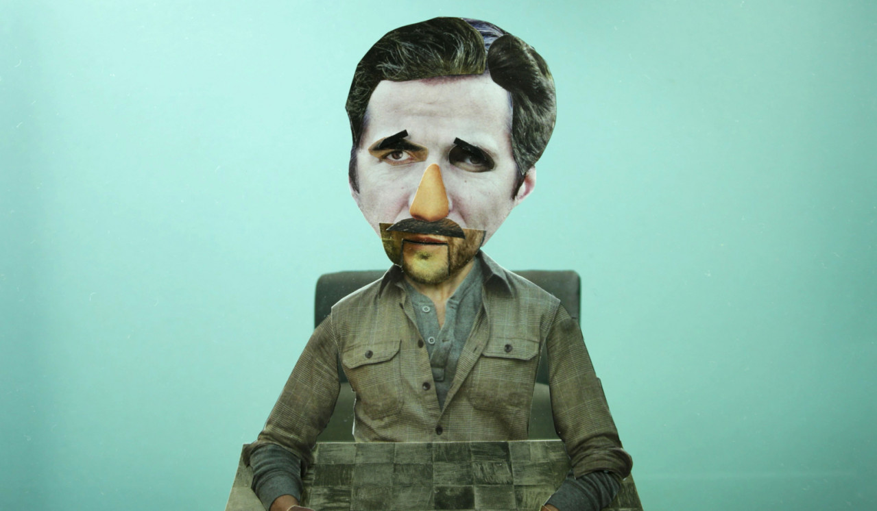 a man made of magazine cut outs