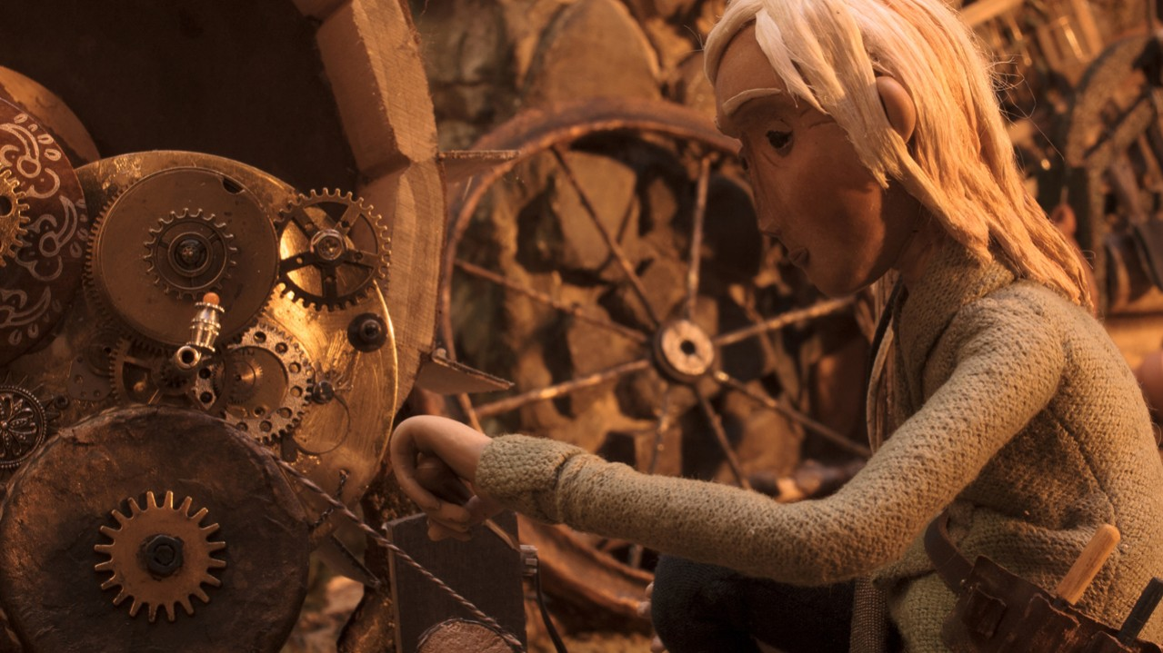 An animated character working on spinning cogs